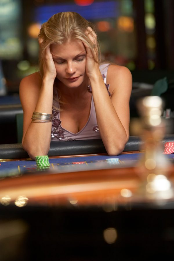 Woman-losing-at-roulette-table